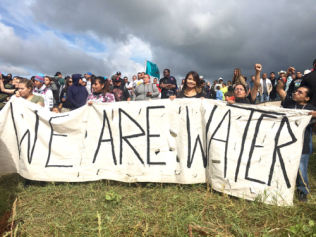 Members of the Episcopal Diocese of North Dakota protesting pipeline near Indian water source and through sacred burial sites.